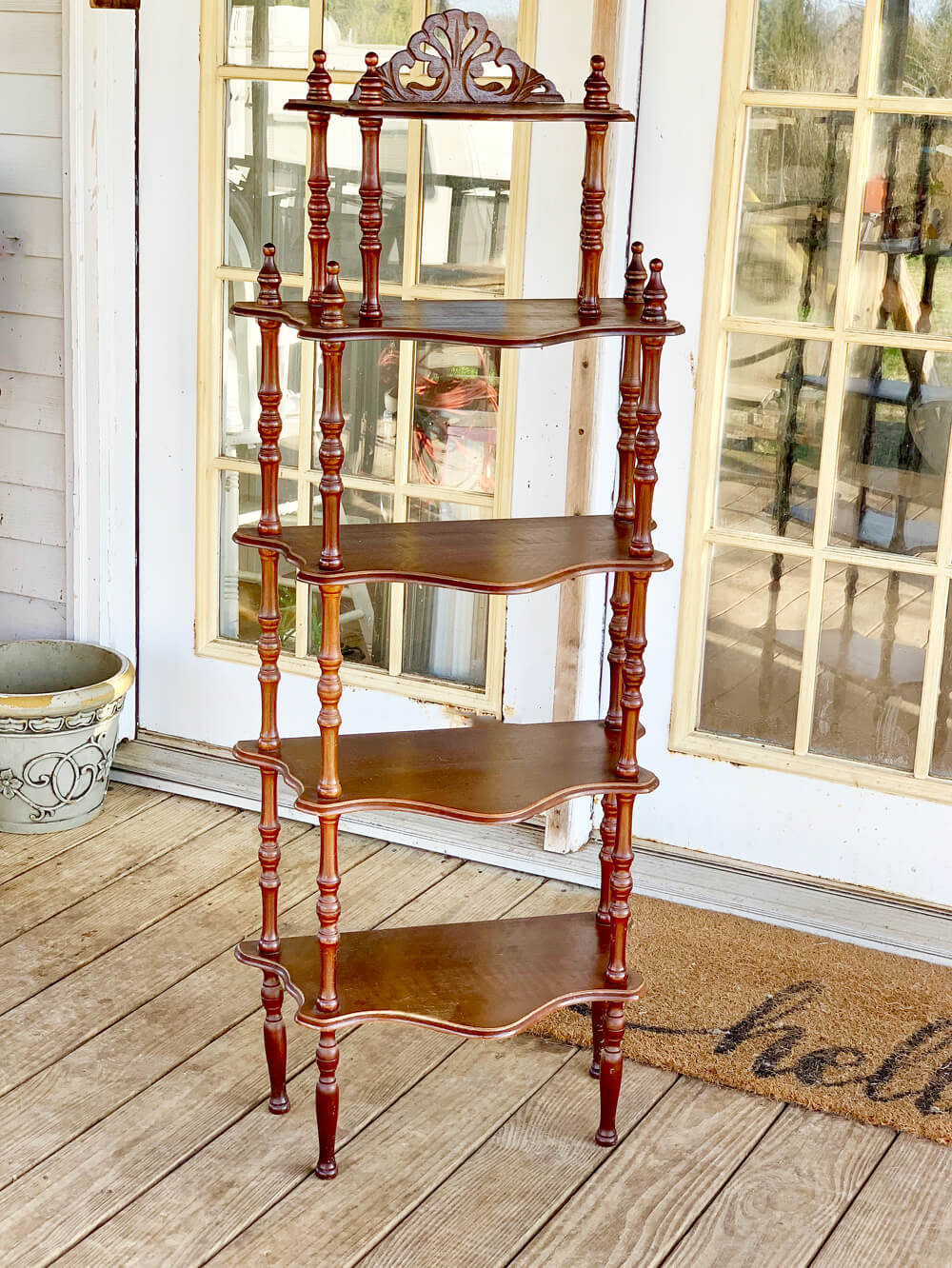 A tall vintage wooden shelf in need of a fun update.